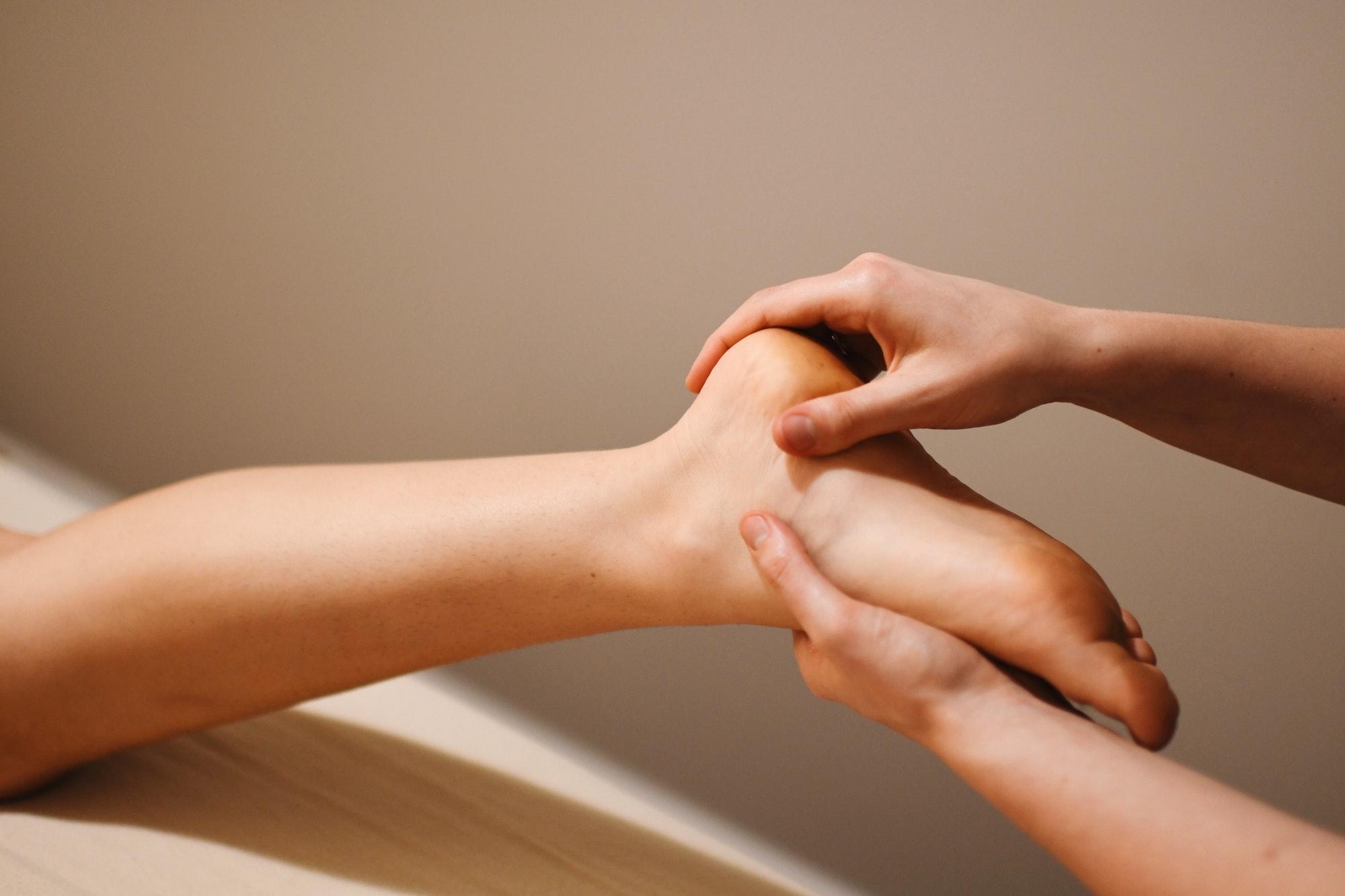 Someone massaging a girls foot