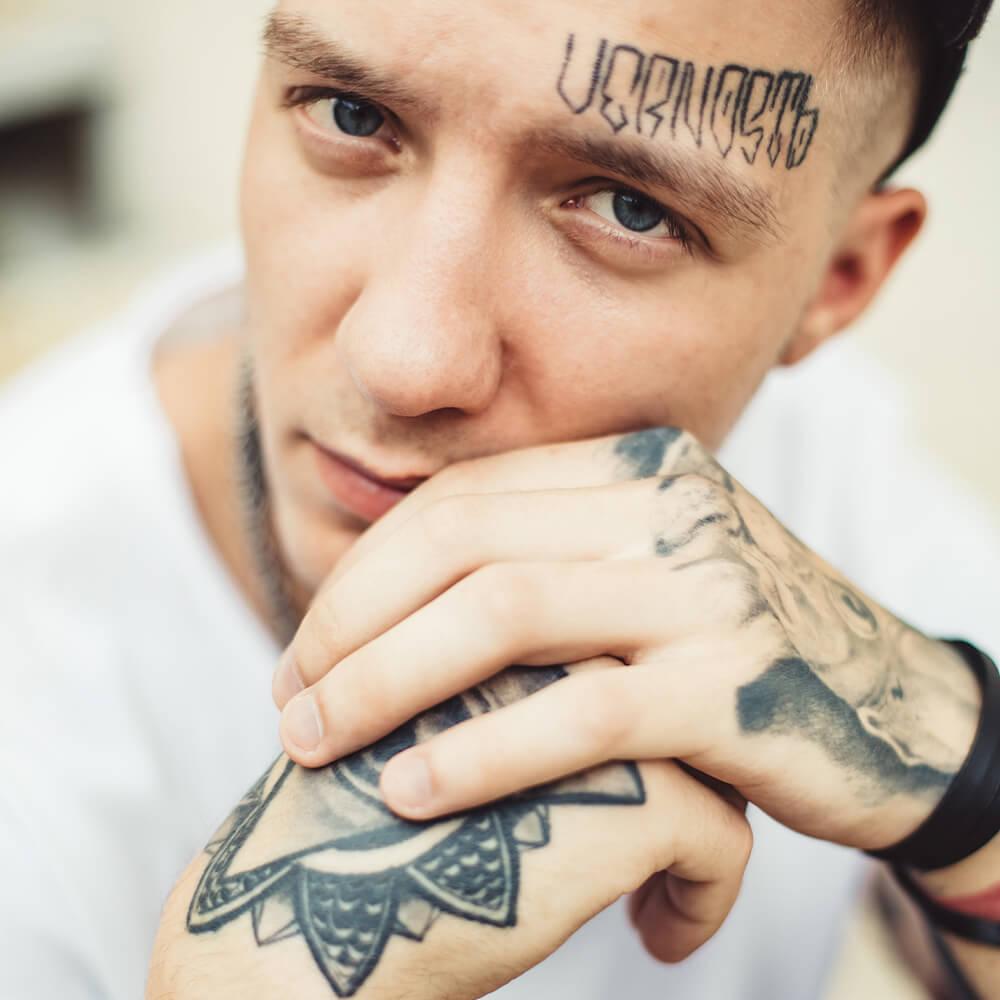 handsome-man-in-tattoos-posing-PKJXPYW.jpg
